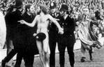 <p>Michael O'Brien is caught after streaking at Twickenham in 1974.</p>