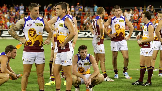 Dejected Lions players after losing the Round 3 QClash with Gold Coast. Picture: Adam Head