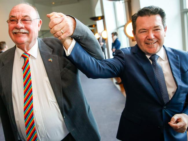 Liberal MP Warren Entsch (left) and Liberal Senator Dean Smith celebrate after parliament passes the same-sex marriage bill. Picture: Sean Davey/AFP