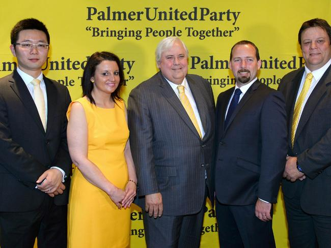 Leader of the Palmer United Party Clive Palmer (C) poses with his PUP senators Dio Wang (L), Jacqui Lambie and Glenn Lazarus (R) along with Australian Motoring Enthusiast Party (AMEP) senator Ricky Muir. Picture: William West