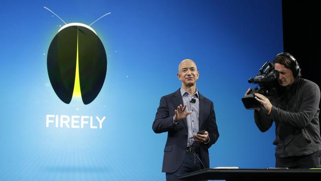 Amazon CEO Jeff Bezos talks about the new Fire Phone's Firefly feature, which lets the user take photos of objects, numbers, artwork or books and have the phone recognise the item. Picture: AP