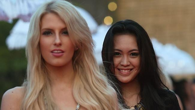 Not going to win ... Miss Australia, Erin Holland, with Miss Indonesia, Vania Larissa, at the GWK cultural centre in Bali, Indonesia. AFP PHOTO / MISS WORLD