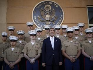 Defenders of the faith ... US Secretary of State John Kerry, centre, poses for a picture with the US Marines based in the Baghdad embassy during his visit in March 24, 2013.