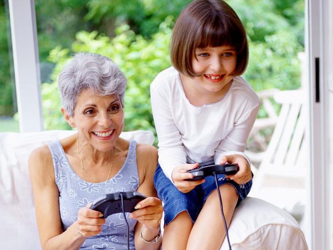 Bonding time ... a young girl plays video games with her grandmother. Picture: Supplied