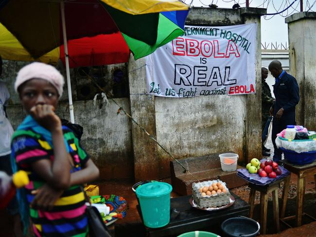Warnings ... an Ebola sign ebola outside a government hospital in Freetown, Sierra Leone.