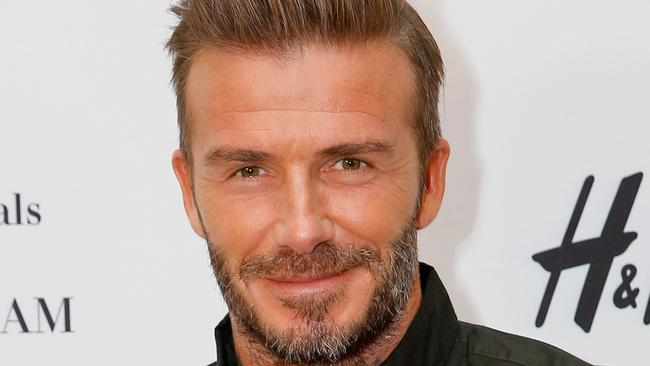 David Beckham Looks Unrecognisable In Guy Ritchies King Arthur Movie - David beckham armani hairstyle
