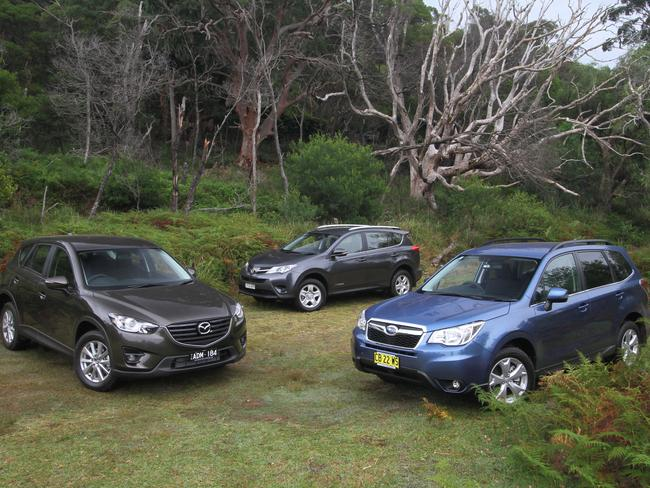 The Mazda CX-5 (left), Toyota RAV4 (centre) and Subaru Forester (right) are becoming commonplace. Picture: Joshua Dowling