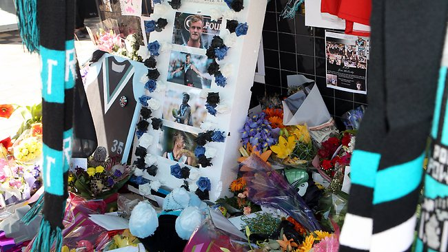 Fans set up a makeshift memorial for Port Adelaide footballer John McCarthy at Alberton Oval.
