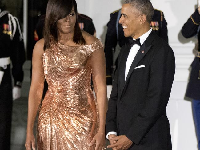 It came a day after she made headlines in a beautiful rose gold Aterlier Versace gown at husband Barack Obama's final State Dinner. Picture: Manuel Balce Ceneta/AP Photo