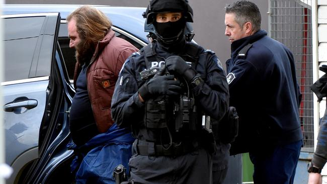 Police arrest Phillip Galea at his house. Picture: Jay Town