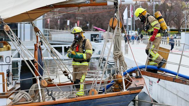 Firefighters with breathing gear hop on board the Windeward Bound. Picture: SAM ROSEWARNE