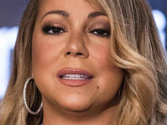 """CORRECTION - US Singer Mariah Carey speaks at a press conference to announce an agreement with Israeli cosmetics brand Premier Dead Sea, in the coastal city of Tel Aviv on June 26, 2017. / AFP PHOTO / JACK GUEZ / """"The erroneous mention[s] appearing in the metadata of this photo by JACK GUEZ has been modified in AFP systems in the following manner: [Dead Sea] instead of [Red Sea]. Please immediately remove the erroneous mention[s] from all your online services and delete it (them) from your servers. If you have been authorized by AFP to distribute it (them) to third parties, please ensure that the same actions are carried out by them. Failure to promptly comply with these instructions will entail liability on your part for any continued or post notification usage. Therefore we thank you very much for all your attention and prompt action. We are sorry for the inconvenience this notification may cause and remain at your disposal for any further information you may require."""""""