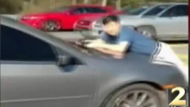 Screenshot of US man Elton Kim, who was left clinging to speeding car after confronting woman who hit his wife's SUV. From http://www.wsbtv.com/news/news/local/video-shows-man-clinging-car-after-hit-and-run/nXgPP/