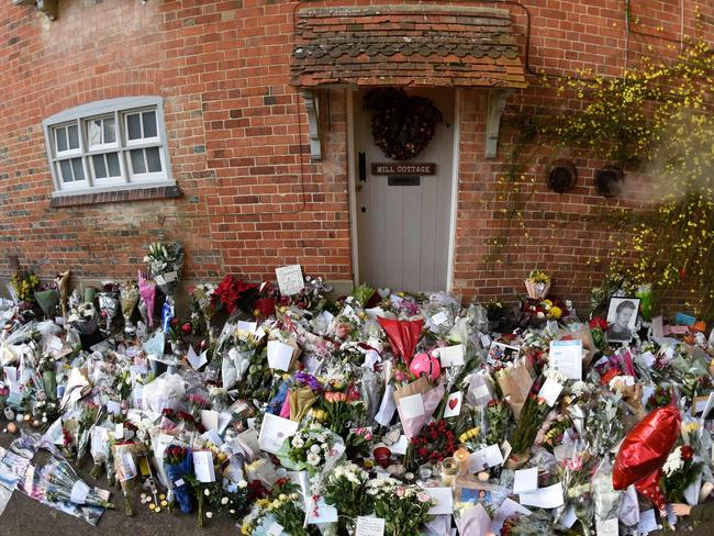 Tributes left outside George Michael's home, where he died, in the village of Goring, southern England. Picture: AFP