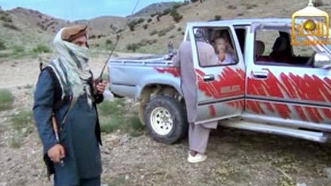 Sgt. Bowe Bergdahl sits in a vehicle guarded by the Taliban in eastern Afghanistan. Picture: Voice Of Jihad Website via AP video