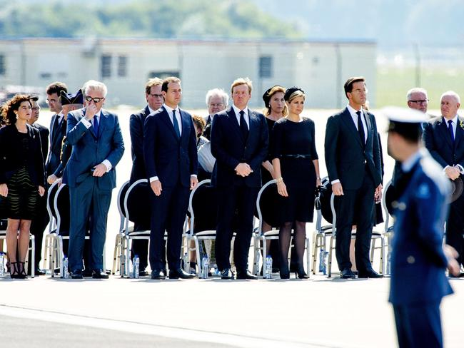 (From L) Prince Laurent of Belgium, Dutch Labor Minister Lodewijk Asscher, King Willem-Alexander and Queen Maxima of The Netherlands, and Dutch Prime minister Mark Rutte attend a ceremony for the victims at Eindhoven Airbase. Picture: Robin van Lonkhuijsen
