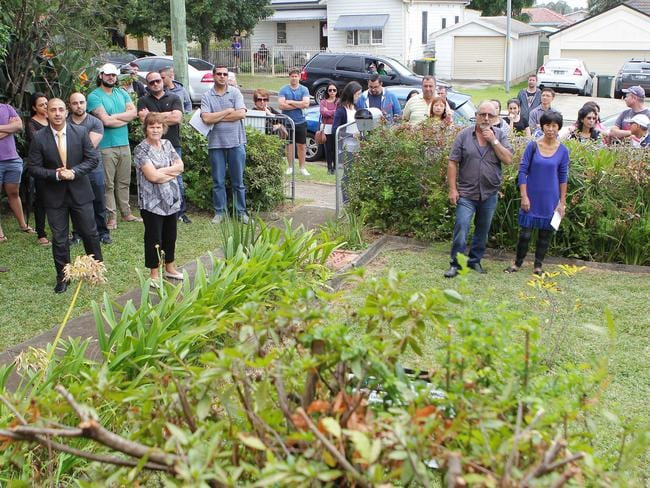 The crowd at the auction of 15 Leigh St, Merrylands today.