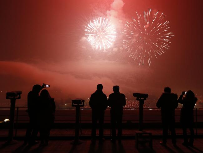 Red overhead ... revellers watch the fireworks at the Imjingak Pavilion near the border village of Panmunjom in Paju, South Korea. Picture: AP Photo/Lee Jin-man