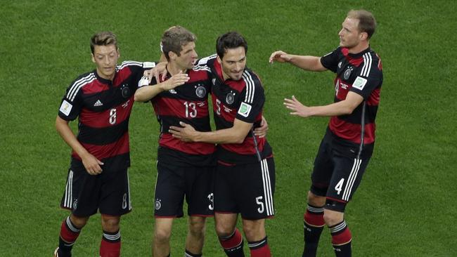 Germany's forward Thomas Mueller (2L) celebrates with Germany's defender Mats Hummels.