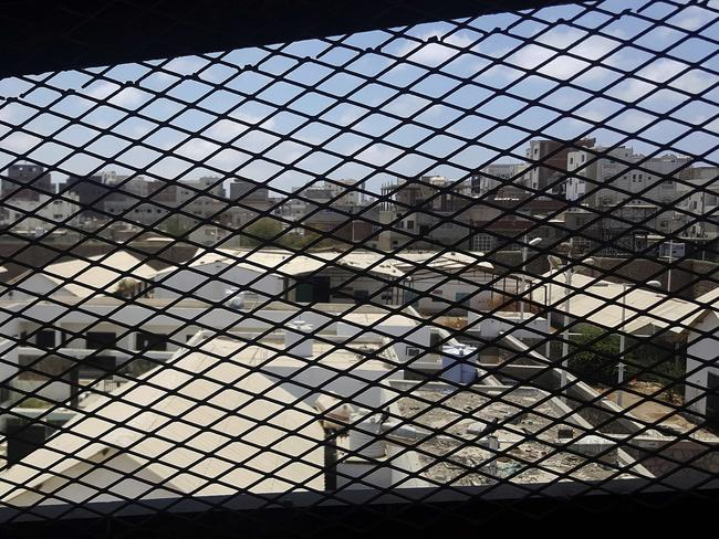 A view through a mesh window looks out over part of Aden Central Prison. Picture: Maad El Zikry/AP
