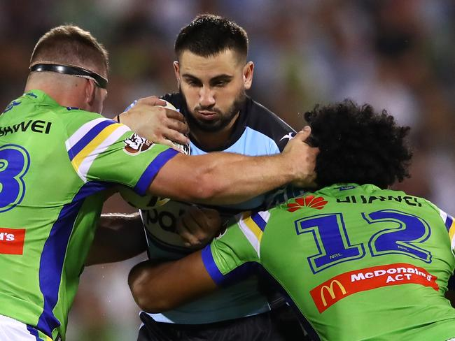 Jack Bird of the Sharks is tackled.