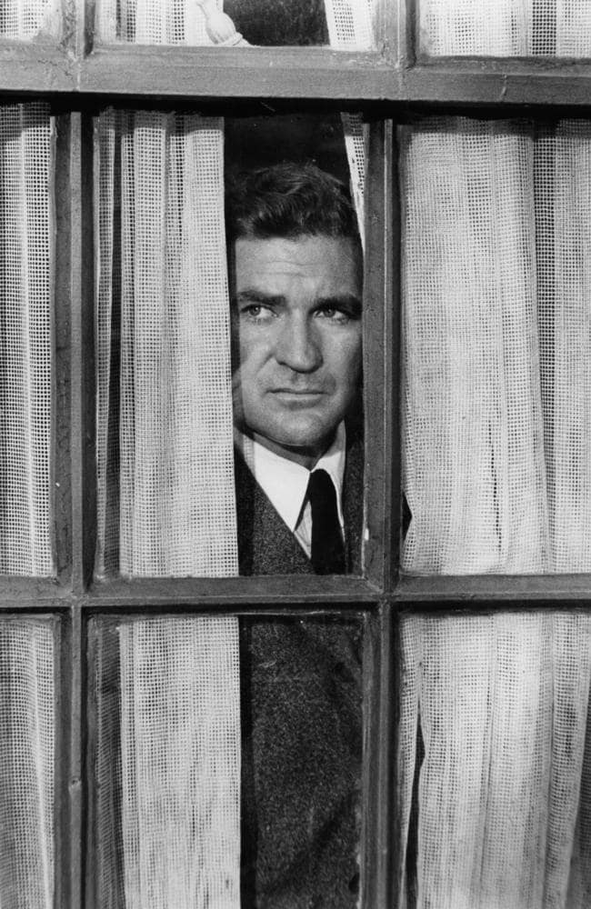 Most famous role: Rod Taylor stares out a window in a scene from Alfred Hitchock's The Birds in 1963. Picture: Universal/Getty Images.