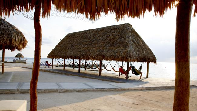 Divers rest on a couple of Scuba Club hammocks. Picture: Lonely Planet