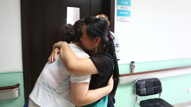 The kidnapped 6-year-old boy's mother hugs a relative at the hospital. Picture: Austral International
