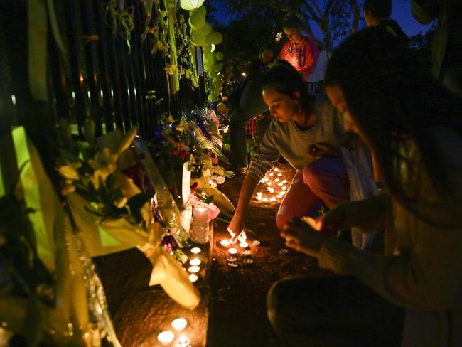 Candles are lit as part of a vigil on the fence of Leeton High School. Photo: Chris McKeen