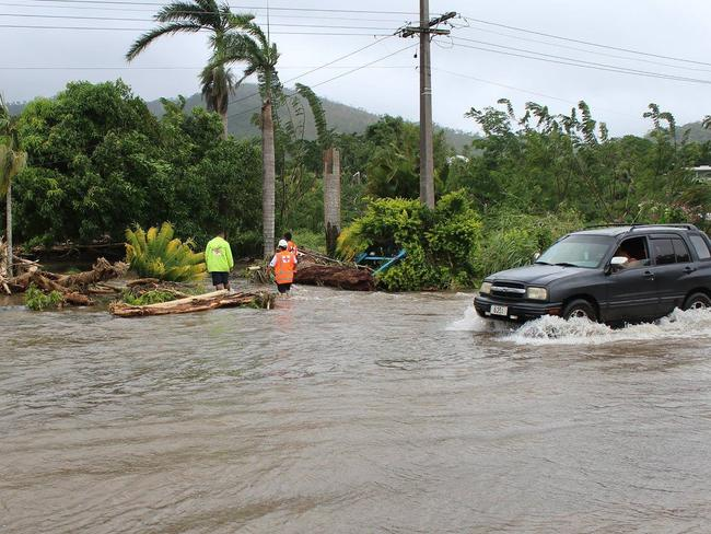Samoa Red Cross workers assess the damage as neighbouring Tonga prepares for a direct hit by the powerful cyclone that is threatening to become a Category Five superstorm. Picture: AFP Photo/Samoa Red Cross