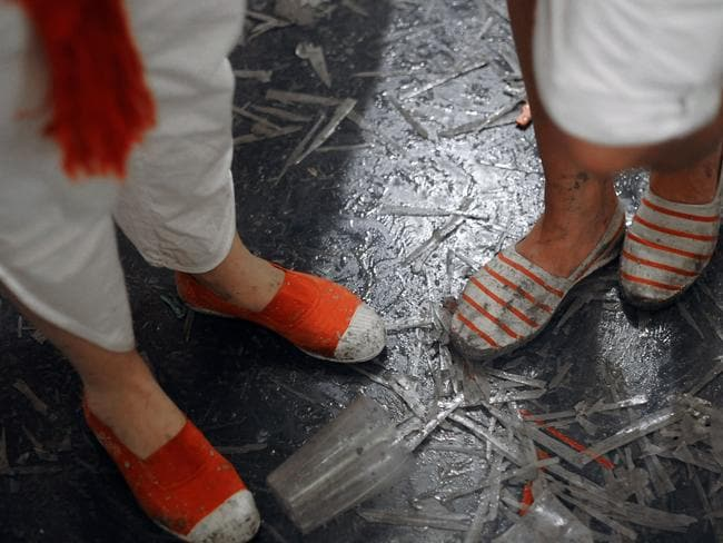 Revellers wear white and red shoes during the San Fermin Festival in Pamplona, northern Spain. The Spanish city of Pamplona, famous for its San Fermin festival that mixes bull runs with round-the-clock drinking, has launched a campaign to stop sexual assaults during the week-long fiesta. AFP PHOTO/ ANDER GILLENEA