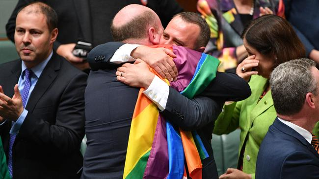 Liberal Member for North Sydney Trent Zimmerman and Liberal Member for Goldstein Tim Wilson celebrate the passing of the Marriage Amendment Bill in the House of Representatives at Parliament House in Canberra, Thursday, December 7, 2017. Picture: AAP /Mick Tsikas.