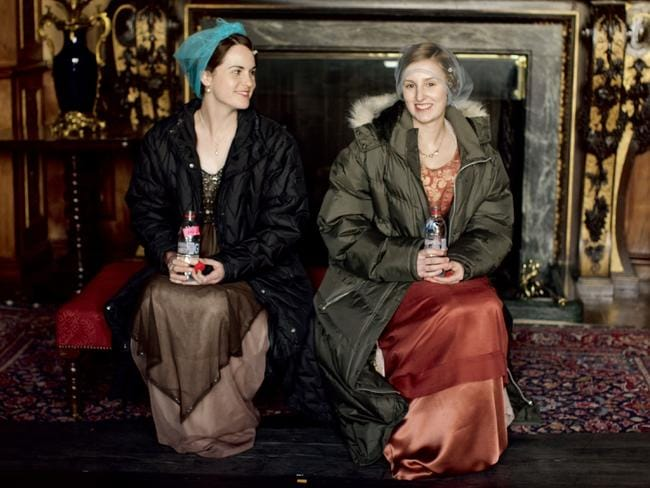 Taking a break ... Michelle Dockery (Lady Mary) and Laura Carmichael (Lady Edith) filming Downton Abbey. Picture: Supplied