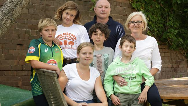 Dieter Winkler and Jacquie Young and their five kids rented a holiday home from Airbnb in Burleigh Heads and one day into their holiday cops raided the property to find a hydroponic cannabis setup in the back room.