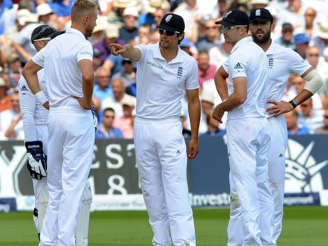 Cook gestures while talking to Stuart Broad, James Anderson and Plunkett at Trent Bridge.