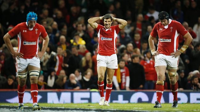 Wales' Mike Phillips, centre, reacts after Australia's Kurtley Beale matchwinning try at the Millennium Stadium in Cardiff. Picture: Matt Dunham