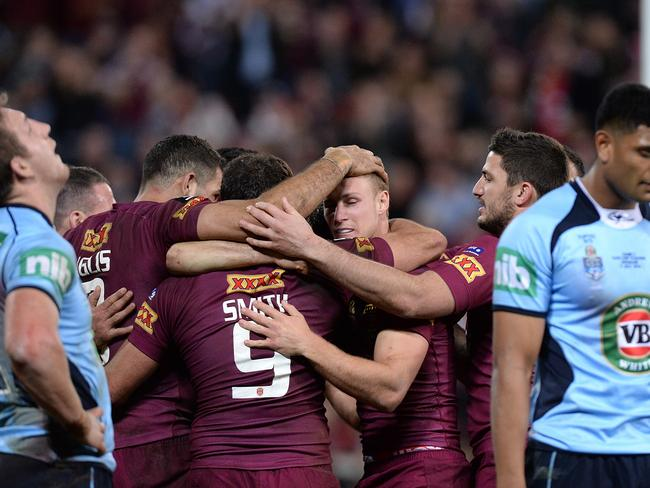 Queensland's Cameron Smith celebrates scoring his side's first-half try after being set up by Daly Cherry-Evans.