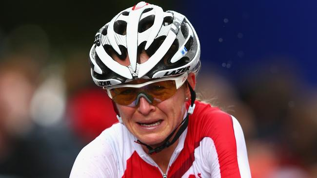 Emma Pooley, racing her final race before retirement, breaks down as she crosses the line to win silver.