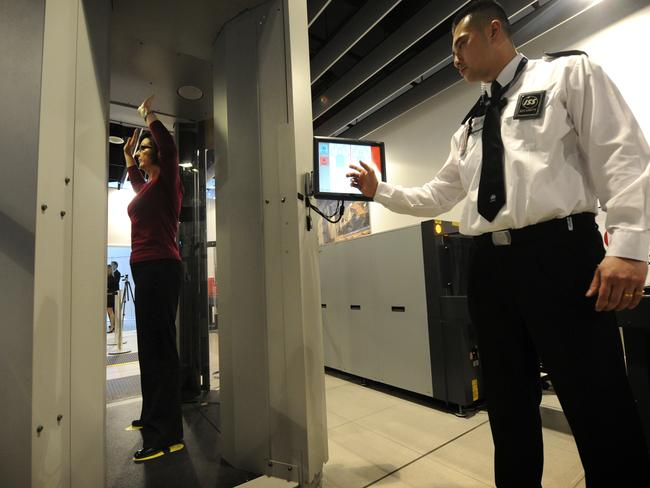 A woman undergoes a full body scan at Melbourne International Airport, a security measure that may be introduced for domestic flights. .