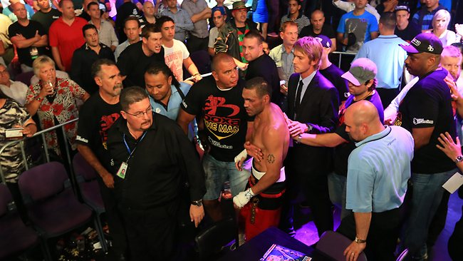 Anthony Mundine walks out in disgust after his loss. Picture: Mark Evans
