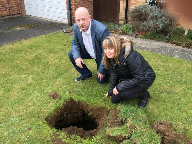 Kevin and Emma James who found a hole in their front garden. Picture: The Sun