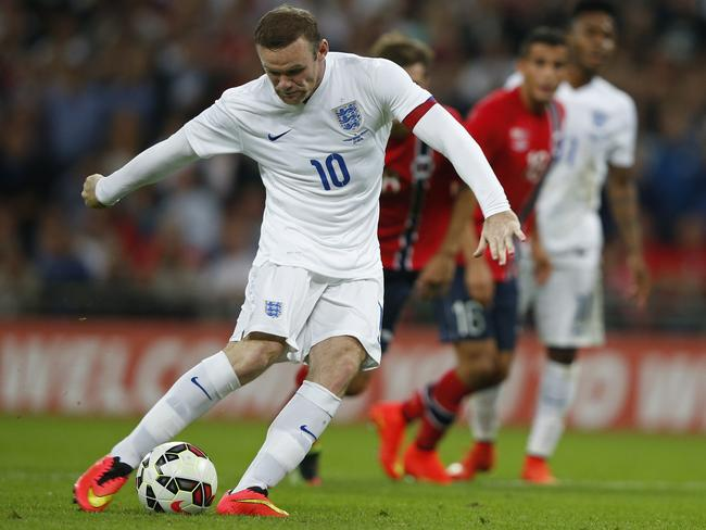 England's Wayne Rooney scores from the penalty spot against Norway at Wembley.