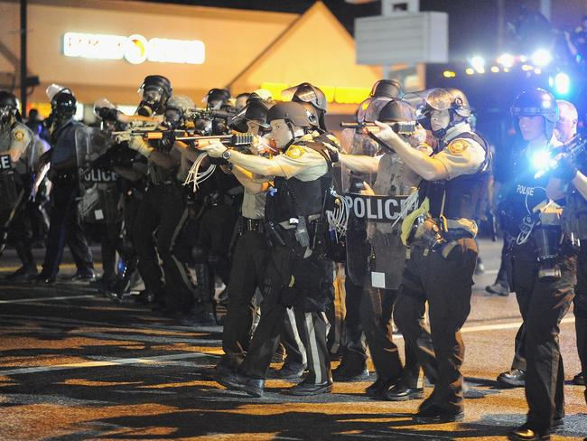 Unrest ... law enforcement officers watch on during a protest on West Florissant Avenue in Ferguson, Missouri.