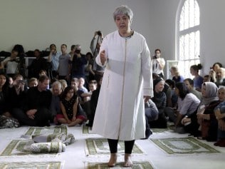 Seyran Ates, standing at center, founder of the Ibn-Rushd-Goethe-Mosque gestures during the opening of the mosque in Berlin, Germany, Friday, June 16, 2017. Ates the 54-year-old daughter of Turkish immigrants has founded the first liberal mosque in Germany where men and women can pray together, homosexuals are welcome and Muslims of all sects can leave their inner-religious conflicts behind. (AP Photo/Michael Sohn)