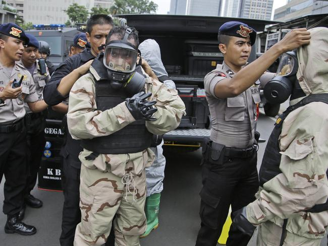 Members of the police bomb squad ... put on their protective gear prior to examining the site where an explosion went off in Jakarta. Picture: AP
