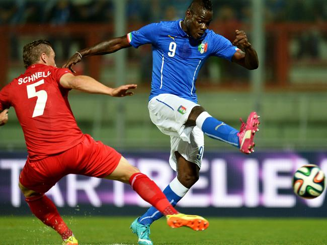 Italy's forward Mario Balotelli (R) vies with Luxembourg defender Tom Schnell.