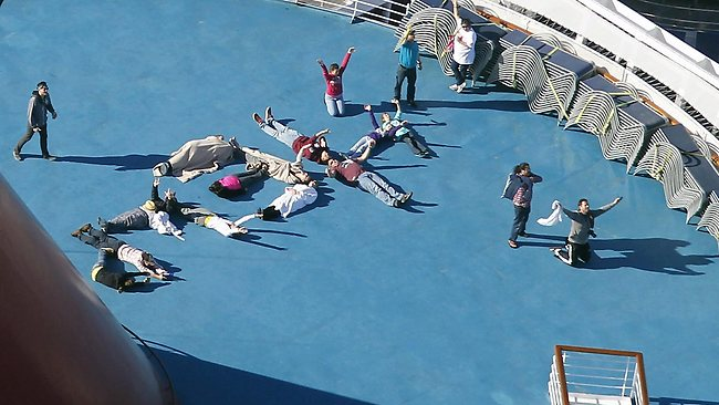 "Passengers spell out the word ""HELP"" aboard the disabled Carnival Lines cruise ship Triumph. Picture: AP/Gerald Herbert"