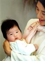 <p>Japan's Crown Princess Masako holds her infant daughter Princess Aiko at their Togu Palace residence in Tokyo in 2002. Picture: Getty</p>