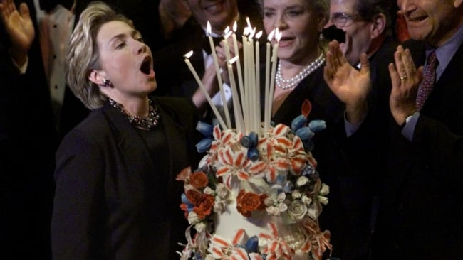 Hillary blowing out the candles on her birthday cake. Photo: File