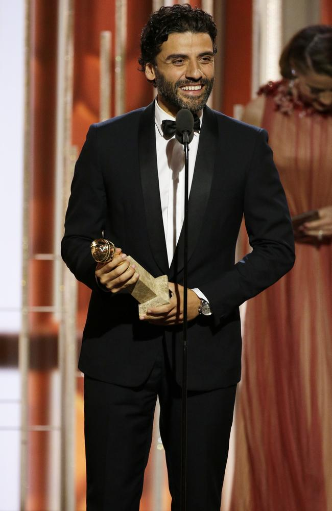 "Oscar Isaac accepts the award for best actor in a limited series or TV movie for his role in ""Show Me A Hero"" at the 73rd Annual Golden Globe Awards on Sunday, Jan. 10, 2016, at the Beverly Hilton Hotel in Beverly Hills, Calif. (Paul Drinkwater/NBC via AP)"